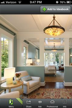 Half walls and columns separate rooms but maintain open feel with class an elegance. Perfect!