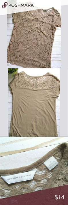 New York & Company short sleeve lace top. New York & Company top with lace layer on the front.  It is a tan/mocha color.  It has a short sleeve.  The back upper part has lace and a zipper.  It was worn only once.  Perfect for summer!!!  Pet free smoke free home. New York & Company Tops