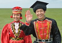 Happy kalmyk couple in amazing traditional dress. Kalmykia, Russia.