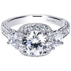 Have we engaged your attention with this 14k White Gold Victorian Halo Engagement Ring?