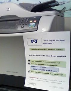 Simple but probably effective: this copier has been upgraded.  Voice commands enabled.