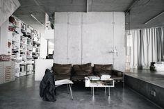 Concrete and that sofa. By architect Arno Brandlhuber, via Lotta Agaton.