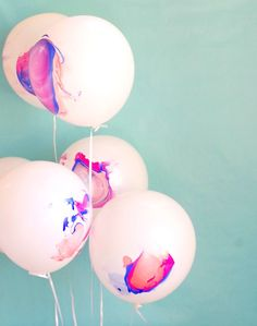 pink, orange and blue balloons that are marbled | val event gal