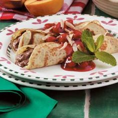 """Chocolate Cherry Crepes Recipe -""""I like this recipe because it is easy to make,"""" says Irene Menninga of Grand Rapids, Michigan.  """"I often prepare the crepes and filling in advance, assembling them and adding the topping just before serving."""""""