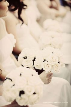 All White with a smidge of black   #Bouquets   Photography: Axioo   On SMP - http://www.StyleMePretty.com/2009/12/09/white-wedding-by-axioo/