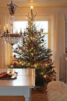 32 Beautiful Scandinavian Christmas Tree For Your Living Room - Traditionally, the Christmas tree was not put up until December, Christmas Eve, and it was taken down on January, Night. The Germans use. Real Christmas Tree, Beautiful Christmas Trees, Merry Little Christmas, Noel Christmas, Country Christmas, Xmas Tree, Winter Christmas, Christmas Tree Decorations, Christmas Photos