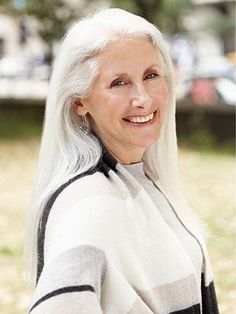 You don't have to get short hair just because you are growing older - long hair on mature women is also beautiful!!
