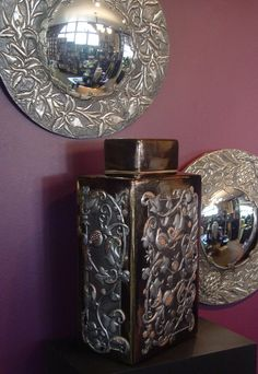 Mimmic pewter ginger jar with beautiful pewter round frames done by my aunt in the 1960's