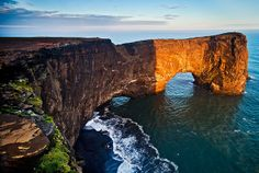 The small peninsula, Dyrhólaey is located on the south coast of Iceland, not far from Vík í Mýrdal. The name of the peninsula means the island with the hill door which is named after a giant sea stack in the area.