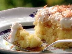 Pina-Colada Cake...1 box yellow cake mix  1 can crushed pineapple  1 can sweetened condensed milk  1 container or frozen whipped topping or fresh whipped cream  1/3 c. toasted coconut (optional)
