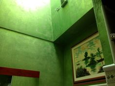 A bathroom with emerald Davinci paint