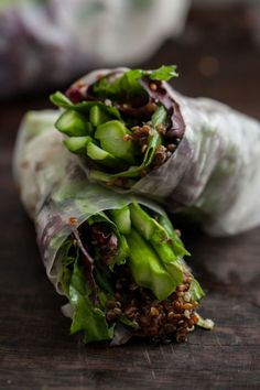 Grilled Asparagus and Chili-Orange Quinoa Spring Rolls: Charred asparagus gets wrapped in a rice noodle blanket and served with an addictive dipping sauce. For more veggie grill recipes, click through!