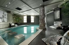 indoor pool designs: cool glamorous indoor swimming pools with natural panel ornaments stones also grey marble as flooring arround at contemporary interior home design stunning indoor swimming pools for luxury lifestyle private luxury swimming pool designs ideas