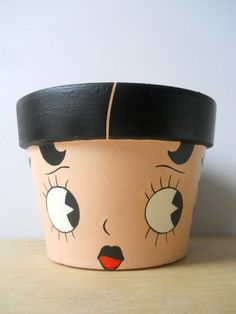 Betty Boop hand painted flower pot by GingerPots on Etsy.really cute idea for painting a flower pot! Flower Pot Art, Clay Flower Pots, Flower Pot Crafts, Clay Pot Projects, Clay Pot Crafts, Diy Crafts, Painted Clay Pots, Painted Flower Pots, Hand Painted