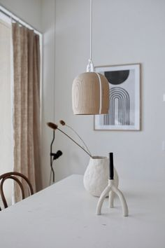 A lovely interior, completed with a Poiju lamp.