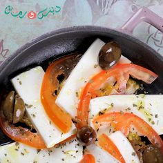 Seasoned Halloumi with tomatoes and olives is a delicious appetizer! Don't you agree?