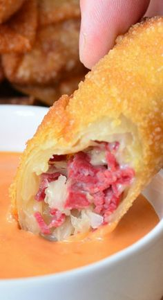 Reuben Egg Rolls ~ Made with corned beef, cheese and sauerkraut, fried to golden deliciousness, and served with Thousand Island dressing.