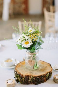 Wedding Themes A simple daisy wedding centerpiece.Your wedding florals do not need to be complicated. These are some favorite simple wedding florals using greenery that look elegant, no one need know you spent less on wedding flower arrangements. Daisy Wedding Centerpieces, Daisy Decorations, Wildflower Centerpieces, Simple Wedding Table Decorations, Wedding Themes, Wedding Table Arrangements, Wedding Colors, Ceremony Decorations, Wedding Dresses