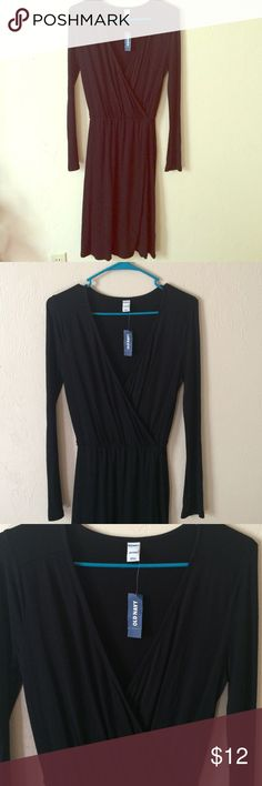 Cross front dress Never worn. Still has the tag on it. The material is very comfortable. Very cute for any formal event! 100% Rayon Old Navy Dresses Long Sleeve