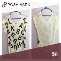 Cute loose shirt with random letters High low shirt that goes over the butt. Forever 21 Tops Blouses