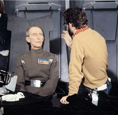 """Grand Moff Tarkin (Peter Cushing) takes direction from George Lucas on the set of """"Star Wars"""""""