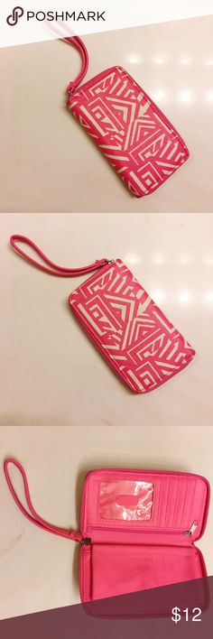Pink Chevron Print Wallet super cute pink and white wallet/wristlet to store all you cards, change and money! this wallet has a clear pouch to put pictures, a zippered pocket to store change & and small strap to hold around your wrist! small stain on this inside (shown in pictures) but could easily be removed! barely used! (price is negotiable so make offers!) Bags Wallets
