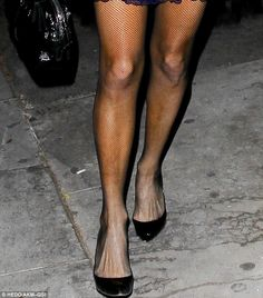 Paris Hilton shows off her tanned legs in thigh-skimming blue dress