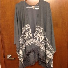 NWT flowy tribal print fringe top Perfect go to outfit for a comfy day at home or dinner out! New with tags and so cute! Tops