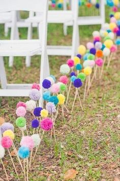 diy paper poms for a fun aisle decoration at an outdoor wedding @myweddingdotcom