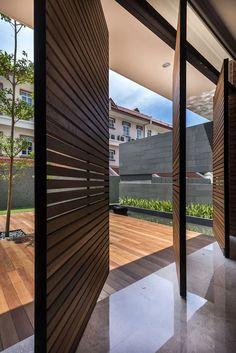 A beautiful combination of pivot doors and slatted wood panels.
