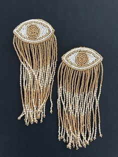 long beautiful gold and white evil eye shoulder duster earrings