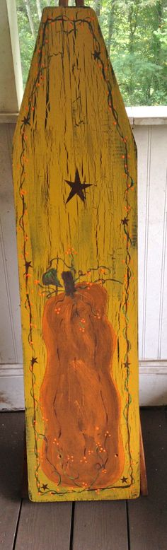 Painted vintage ironing board.