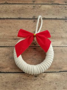Check out this item in my Etsy shop https://www.etsy.com/listing/494101143/ivory-rope-wrapped-wreath-embellished