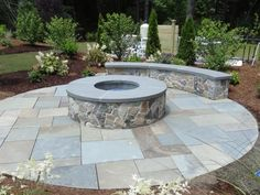 Natural cleft bluestone patio and Boston blend mosiac fire pit and wall with bluestone caps