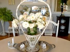 A vintage white basket atop an old silver tray.  Beautiful for a spring table centerpiece.