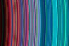 SATURN'S RAINBOW RINGS This colorful cosmic rainbow portrays a section of Saturn's beautiful rings, four centuries after they were discovered by Galileo Galilei. The variation in the color of the rings arises from the differences in their composition. Turquoise-hued rings contain particles of nearly pure water ice, whereas reddish rings contain ice particles with more contaminants.