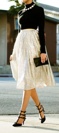 Street style | Silver sequined skirt, turtle neck black sweater and statement necklace