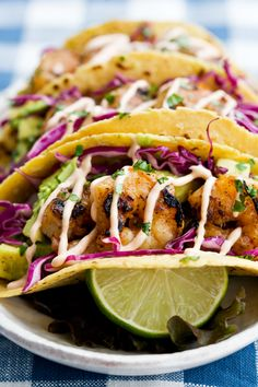 honey lime tequila shrimp tacos with avocado, purple slaw and chipotle crema