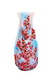 Groovy expandable vase. Folds flat. Easy to ship for a fun, easy gift. bliss.shoptiques.com