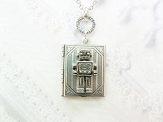 Silver Locket Necklace  Silver Robot Book Locket  by birdzNbeez.  I love just about everything in this seller's etsy shop
