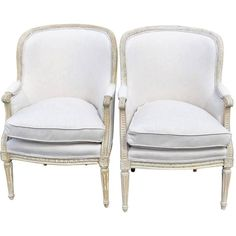 Pair of Distressed Cream Painted Carved Bergeres | See more antique and modern Bergere Chairs at https://www.1stdibs.com/furniture/seating/bergere-chairs
