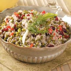 Festive Rice Salad. Can add pork tenderloin, marinated chicken or sausage to make this a main dish.