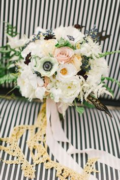 White anemone bridal bouquet | Flowers by Hey Gorgeous Events | Read more - http://www.100layercake.com/blog/2013/10/14/halloween-masquerade-wedding-inspiration/