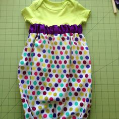 photo 11 of 11 Sew your bottom casing shut when you're finished zig zagging the elastic and that is it! Your gown is now complete! All in all, an easy 30 minute project. Baby Nightgown, Baby Gown, Vinyl Clothing, Clothing Ideas, How To Make Clothes, Making Clothes, Onesies, Baby Onesie, Baby Bibs