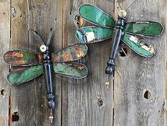 I made these two dragonflies using an old metal sign and a discarded chair leg! They are great to hang indoors or outdoors!