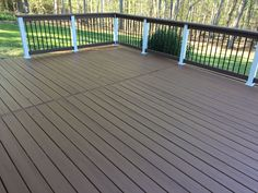 Trex Spiced Rum Decking With White Post Sleeves And Black