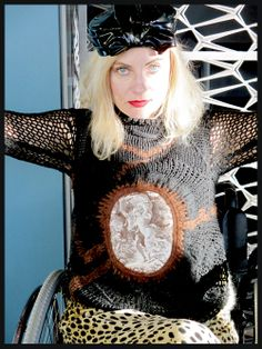 #Wheelchair #Streetstyle. Magdalena of PrettyCripple.com at the #JeanPaulGaultier #BrooklynMuseum exhibit in NY wearing a Gaultier sweater.