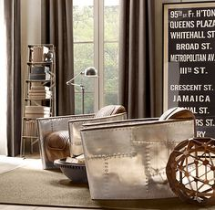 """""""Aviator Chair"""" in Distressed Whiskey Leather from Restoration Hardware - A chair that combines the style of a rugged leather aviators jacket and the polished, riveted aluminum panels of a vintage aircraft."""