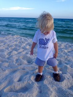 Are you searching for an adorable outfit for your son to wear this summer? This personalized whale outfit would be so cute for your beach vacation.  This outfit has a navy seersucker whale applique top. It is available as a onesie (newborn, 0-3 mos, 6-12 mos, 12-18 mos, 24mos) or a tshirt (6-12 mos, 12-18 mos, 2, 4, or 6) And a pair of navy seersucker shorts.  It is personalized with your sons name for free.  Your little man will look adorable in his new outfit.  Made to order.