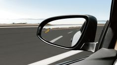 Clear, wide-angled side-view mirror.
